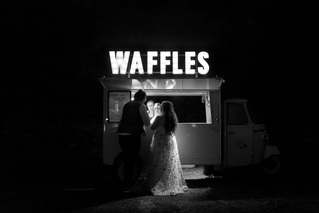 Borders Photographer photographs bride and groom on their wedding day at Neidpath Castle outside a Waffle Tuktuk.