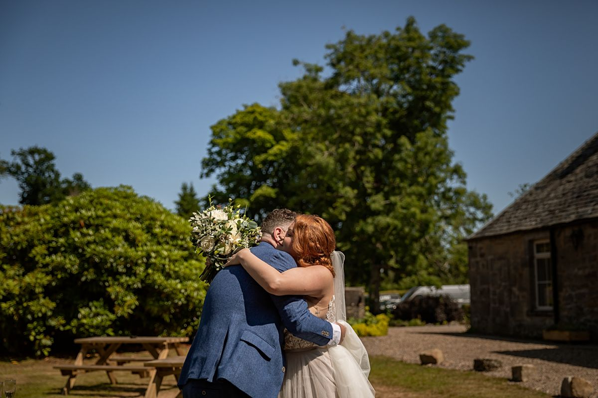 Bride and Groom hugging after getting married, caputured by Enamay photography